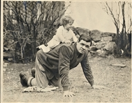 BABE RUTH WITH HIS DAUGHTER RIDING ON HIS BACK