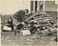 BABE RUTH CHOPPING WOOD AT HIS MASSACHUSETTS HOME