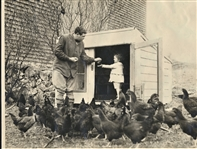 BABE RUTH WITH DAUGHTER FEEDING THE CHICKENS