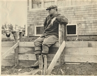 BABE RUTH SITTING ON FENCE AT HIS MASSACHUSETTS HOME
